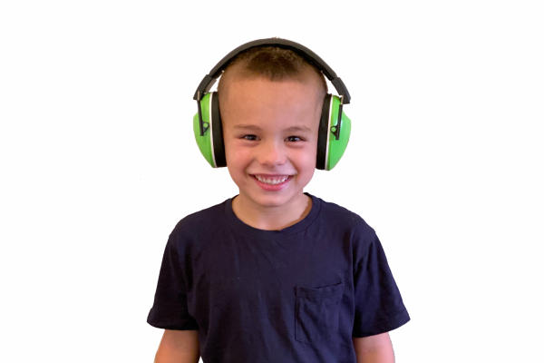Young boy wearing noise reducing headphones to assist with auditory sensory avoidance by minimising auditory input