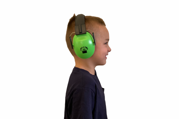 Side on view of child with noise reducing headphones
