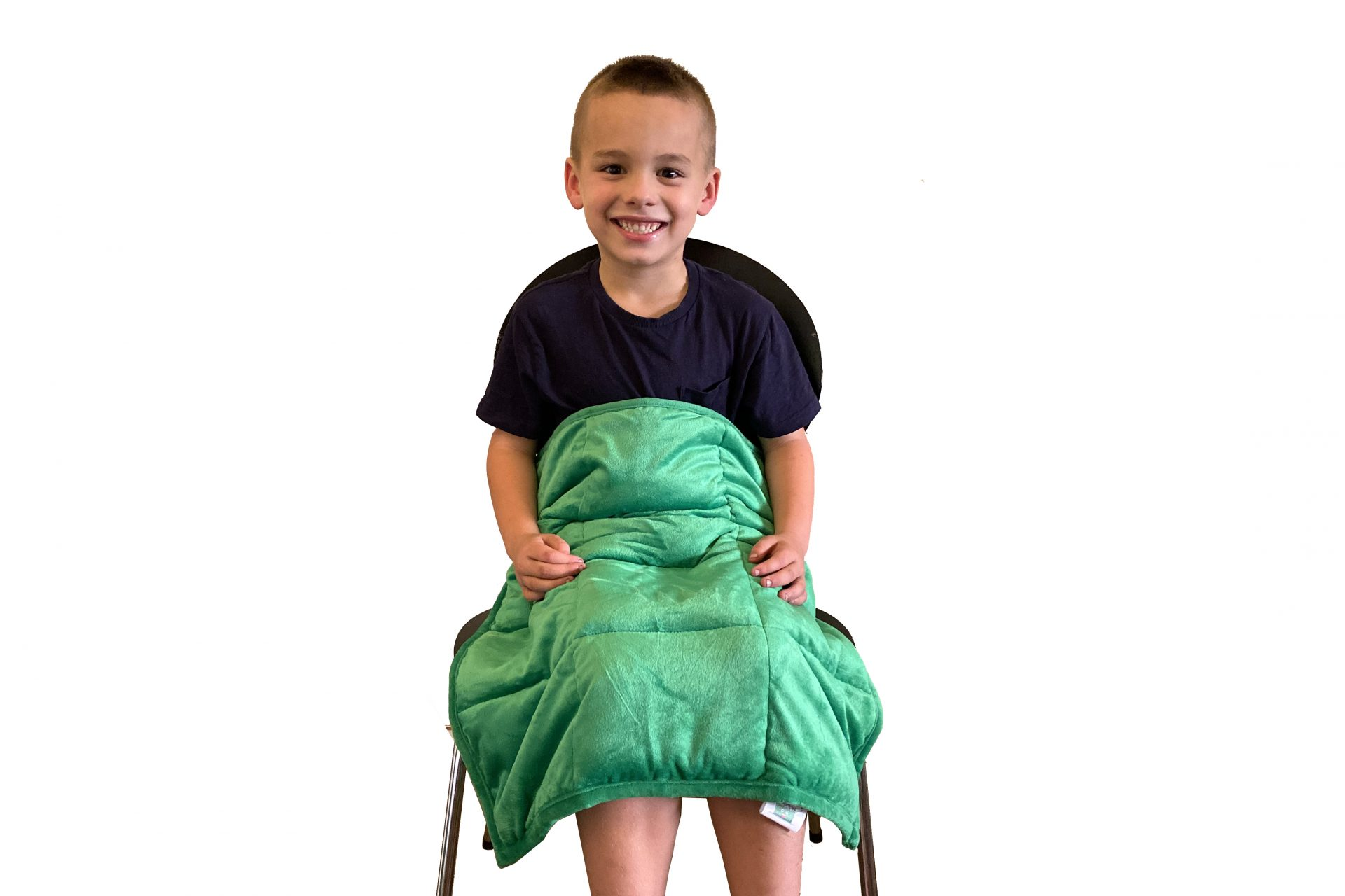 Child with weighted blanked to assist with self-regulation through proprioception and tactile stimulation